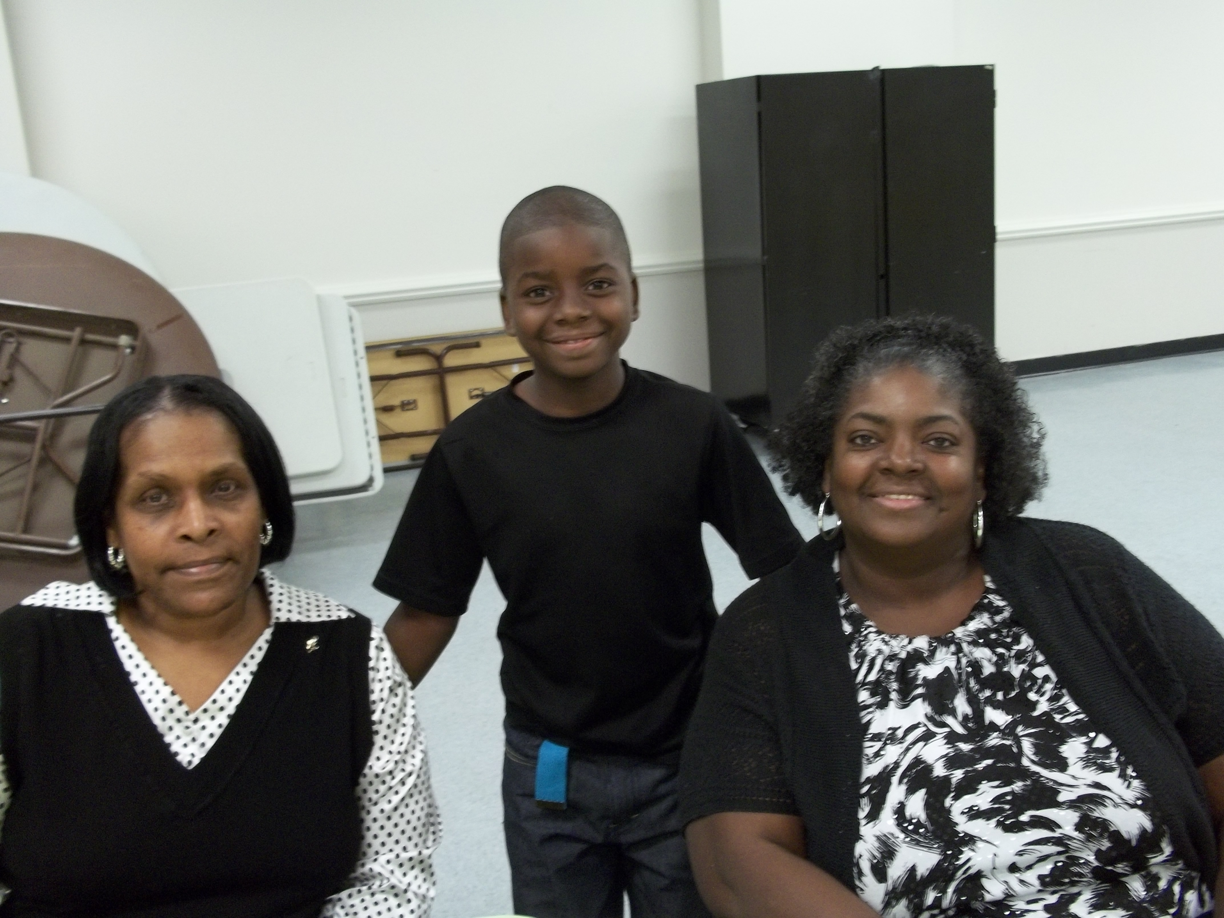Jamonte Riggins with his tutor Olive and Mom